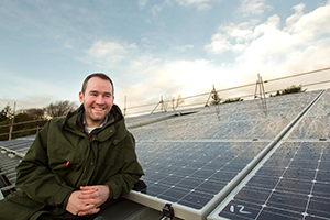 """Matt Hastings from the Eden Project in front of the """"SolarFair"""" PV panels"""